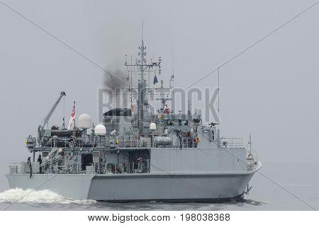MINEHUNTER - Portrait of an English naval ship at sea