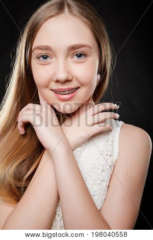Portrait Of Teen Girl Showing Dental Braces.