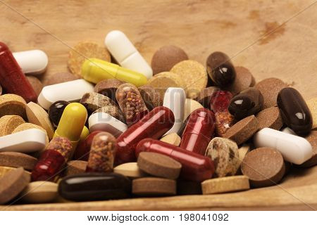 Pills. Pharmacy theme cure in container for health. Heap of red orange white round capsule pills with medicine antibiotic in packages. Drug prescription for treatment medication. Pharmaceutical medicament