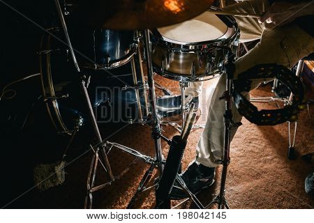 Drum kit during live concert closeup. Professional background. Atmospheric rock show