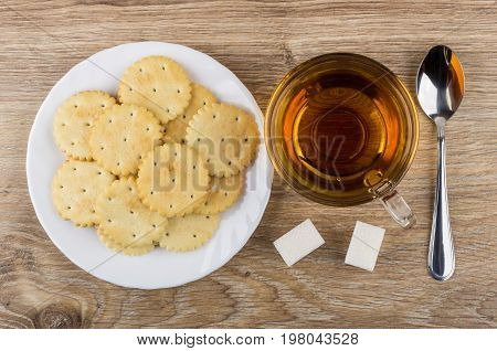 Crackers In Plate, Cup Of Tea, Sugar And Teaspoon