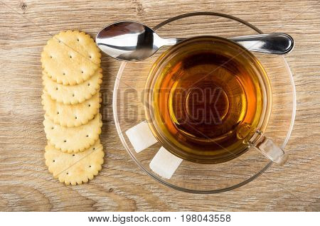 Crackers, Cup Of Tea, Lumpy Sugar And Teaspoon On Table