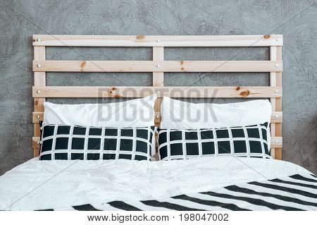 Two Pillows With Checkered Pattern