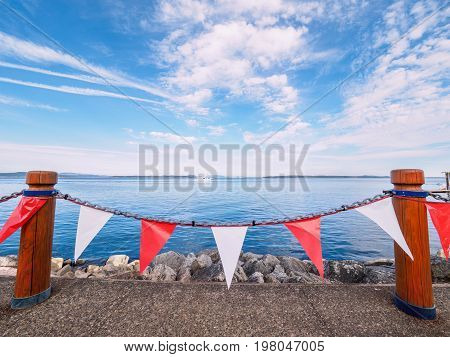 Red and white banners decorate the seaside walk in Sidney Vancouver Island British Columbia to celebrate Canada 150 anniversary