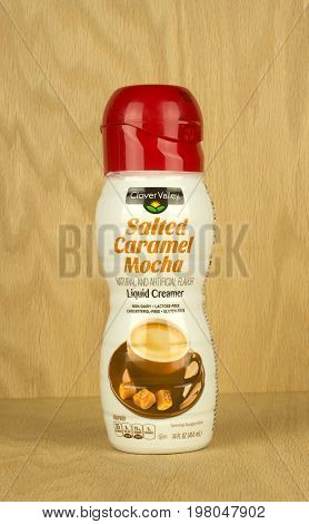 RIVER FALLS,WISCONSIN-AUGUST 02,2017: A container of Clover Valley brand coffee creamer flavored with salted caramel mocha.
