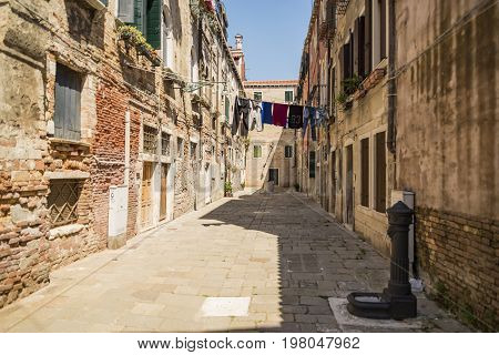 Old buildings and street in Venice Italy