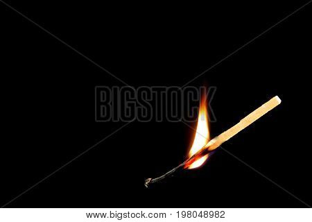 The match was ignited on a black background.
