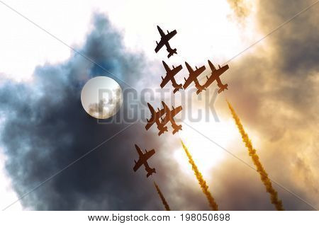 Airplane Group Fighter Against The Background Of The Solar Disk And Clouds