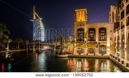 Dubai, UAE - May 31, 2013: Cityscape of Jumeirah beach with Burj El Arab Hotel. Dubai, United Arab Emirates