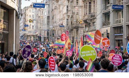 IstanbulL, Turkey - JUNE 30, 2013: People in Taksim Square for LGBT pride parade in Istanbul, Turkey. Almost 100.000 people attracted to pride parade and the biggest pride ever held in Turkey.