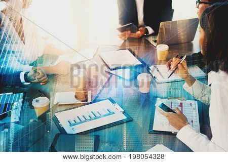 Team of business people work together in office with modern effect. Concept of teamwork and partnership