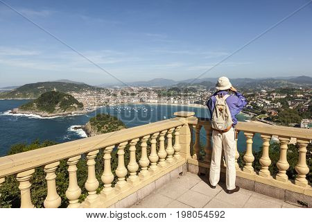 San Sebastian Spain - June 7 2017: Tourist enjoying the view over the La Concha bay in San Sebastian. Basque country Spain
