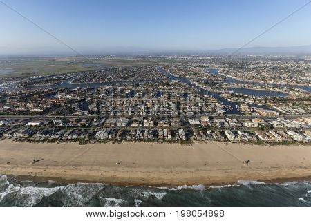 Aerial of Sunset Beach shoreline homes in Orange County, California.