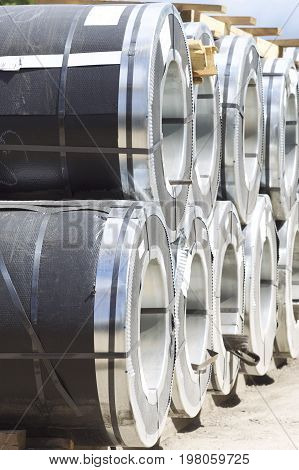 Rolls of cold-rolled galvanized steel with polymer coating in stock