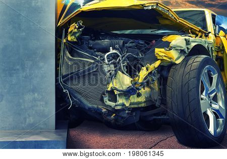 Luxury yellow car crashed into pole on road closeup.