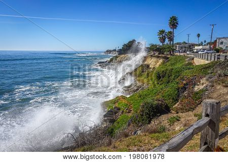 Waves crash and spray the bluffs along the Pacific coast in Capitola California