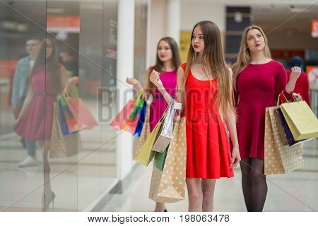 After day shopping. Close-up of young woman carrying shopping bags while walking