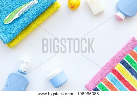Personal care. Towels, soap and shampoo, cream on white backgrond top view.