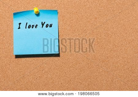 I LOVE YOU hand writting lettering pinned at cork board.