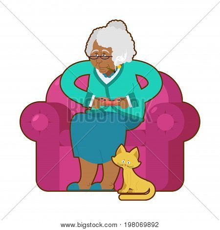 African American Grandmother And Joystick. Black Granny Play Video Games. Old Woman On An Armchair W