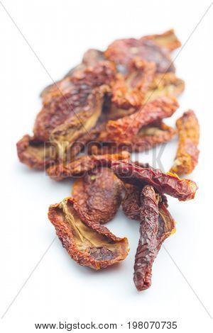 Dried sliced tomatoes isolated on white background. Tomatoes as superfood.