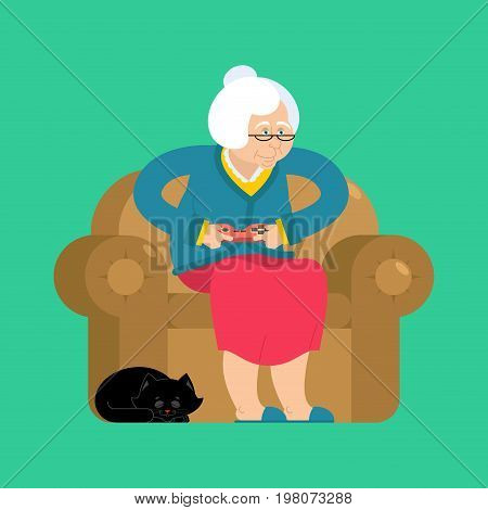 Grandmother And Joystick. Granny Play Video Games. Old Woman On An Armchair With Gamepad. Cat And El