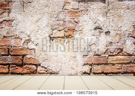 Whtie wooden counter with brick wall background