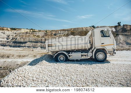 Truck brought waste chalk quarry. Limestone mining, toned