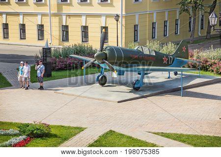 RUSSIA NIZHNY NOVGOROD - JULY 28 2017: Tourists near the mock-up of an aircraft in the Nizhny Novgorod Kremlin