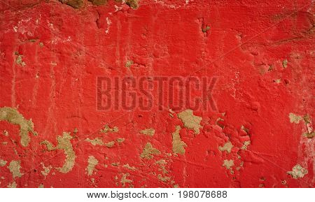 Background of a red stucco coated and painted exterior rough cast of cement and concrete wall texture decorative rustic coating