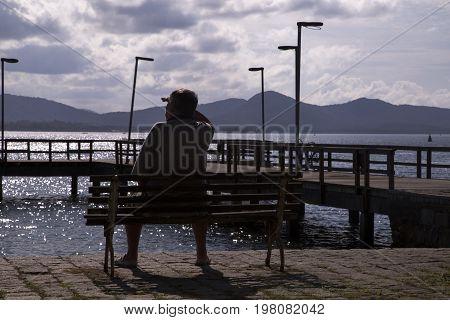 Man Sitting Looking At The Sea. Sao Francisco Do Sul. Santa Catarina. July 2017