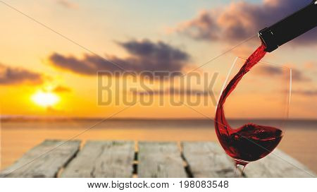 Red glass pouring wine color background party