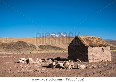 Small house in remote area of Altiplano. Mountains of Altiplano Bolivia South America