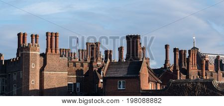 Chimneys And Parapets On Tudor Architecture Red Brick Building Skyline