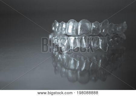 Plastic dental orthodontics on colored background. No people