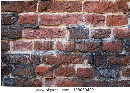 Close-up Of Red Brick Tudor Architeture Exterior Wall