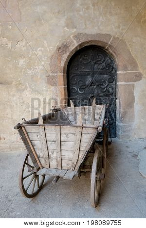 Medieval old wooden cart with four wheels