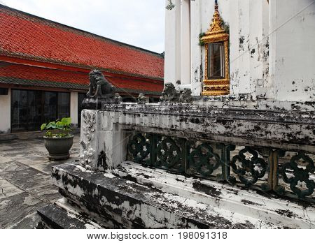 part of Beautiful Wat Phra Kaeo temple with red roof in Thailand