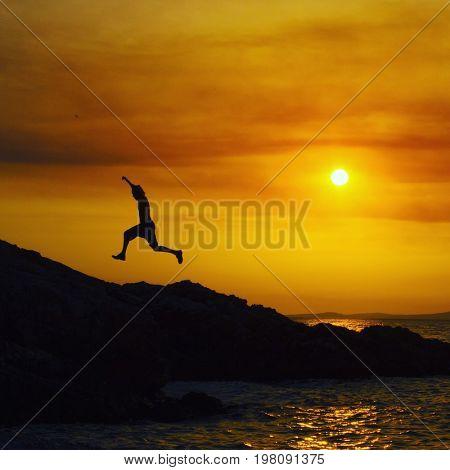 Man jumping at sunset