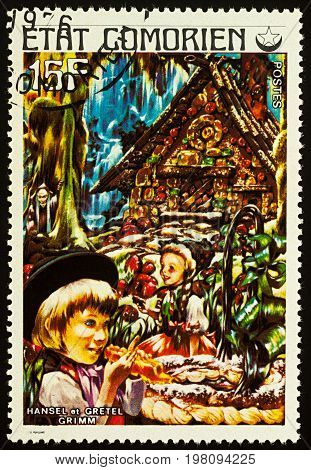 Moscow Russia - August 02 2017: A stamp printed in Comoros shows scene from a fairy tale Hansel and Gretel series