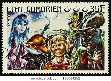 Moscow Russia - August 02 2017: A stamp printed in Comoros shows scene from a fairy tale Pinocchio series