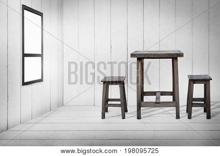 Old wooden table and old wooden chairs in wooden room wooden floor and wooden wall with glass windows