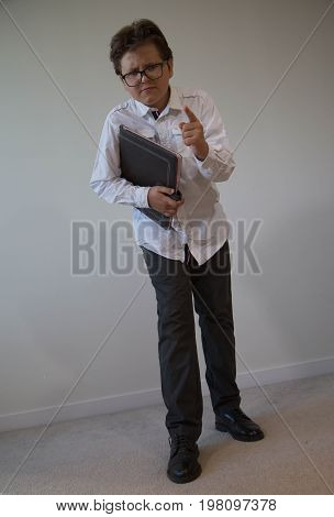 Serious unhappy teen boy wearing business cloth concept bullying