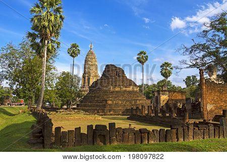 Old pagoda Wat Phra Si Ratanamahathat temple and wall in Sisatchanalai Historical Park Sukhothai province Thailand