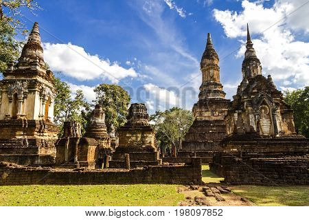 Wat Chedi Chet Thaeo temple and cloud sky in Sisatchanalai Historical Park Sukhothai province Thailand