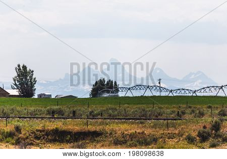 Watering Fields Near Teton Mountains