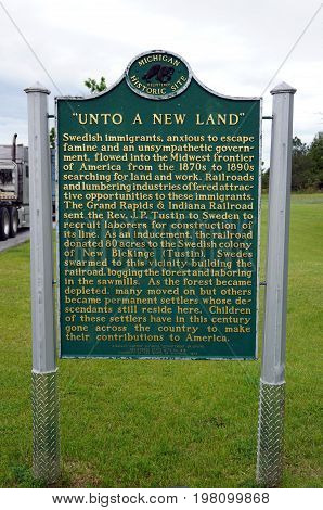 TUSTIN, MICHIGAN / UNITED STATES - MAY 31, 2017: A sign in the Tustin Rest Area and Scenic Overlook, on Highway 131, describes the history of Swedish immigrants to the area.