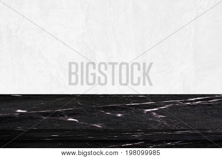 Empty black marble table over white cement wall background product display montage
