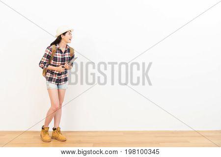 Happy Beautiful Woman Standing On Wooden Floor