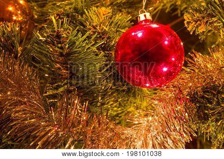 A close up of christmas decorations hanging on a christmas tree